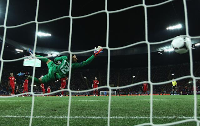 KHARKOV, UKRAINE - JUNE 17: Rui Patricio of Portugal dives as he attempts to stop Rafael van der Vaart (not pictured) of Netherlands scoring the opening goal past during the UEFA EURO 2012 group B match between Portugal and Netherlands at Metalist Stadium on June 17, 2012 in Kharkov, Ukraine. (Photo by Ian Walton/Getty Images)