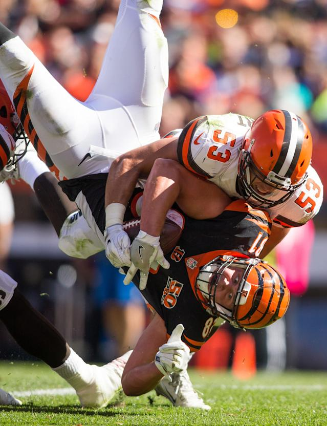 <p>Cincinnati Bengals tight end Tyler Kroft (81) makes a touchdown reception while being hit by Cleveland Browns middle linebacker Joe Schobert (53) during the third quarter at FirstEnergy Stadium. Mandatory Credit: Scott R. Galvin-USA TODAY Sports </p>