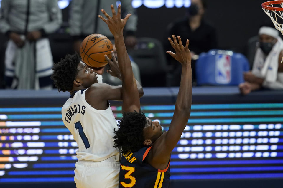Minnesota Timberwolves guard Anthony Edwards (1) shoots over Golden State Warriors center James Wiseman during the first half of an NBA basketball game in San Francisco, Wednesday, Jan. 27, 2021. (AP Photo/Jeff Chiu)