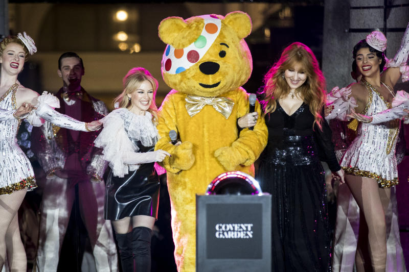 LONDON, ENGLAND - NOVEMBER 14: Kylie Minogue, Charlotte Tilbury and BBC Children in Need's Pudsey Bear switch on the Covent Garden Christmas lights at Covent Garden on November 14, 2017 in London, England. (Photo by Tristan Fewings/Getty Images)