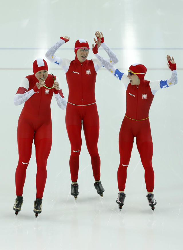 Speedskaters from Poland, left to right, Natalia Czerwonka, Katarzyna Bachleda-Curus and Luiza Zlotkowska celebrate after qualifying after their women's speedskating team pursuit semifinals at the Adler Arena Skating Center at the 2014 Winter Olympics, Saturday, Feb. 22, 2014, in Sochi, Russia. (AP Photo/Patrick Semansky)