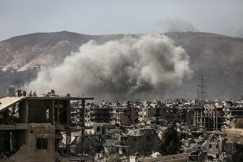 Smoke billows following a reported air strike in the rebel-held parts of Jobar district, on the eastern outskirts of the Syrian capital Damascus, on March 19, 2017