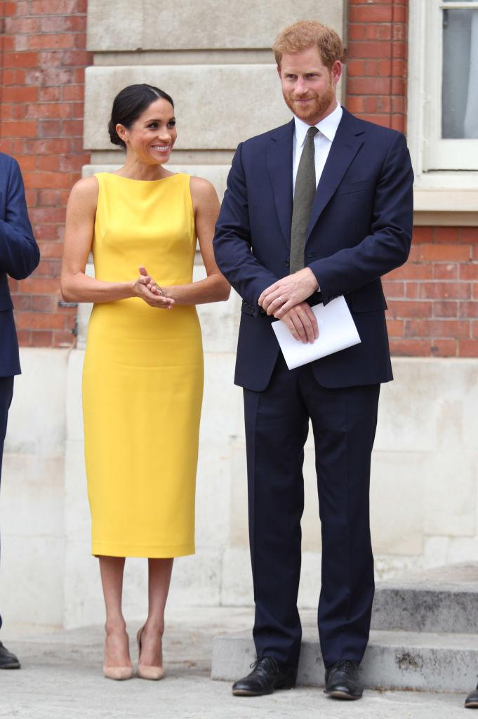 <p>The Duchess of Sussex wore a tailored sheath dress in a bold yellow hue for the Commonwealth Youth Challenge reception in July 2018. <em>(Image via Getty Images)</em></p>