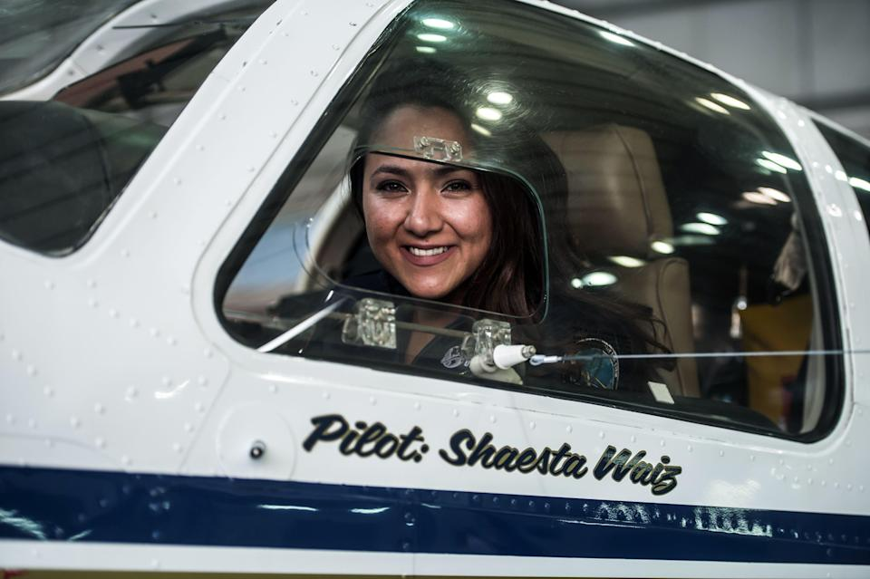 Shaesta Waiz, Afghanistans first female certified civilian pilot, poses for a picture from inside her plane at Cairo International Airport in 2017 during her bid to become youngest woman in history to complete a solo round-the-world flight. (Photo: KHALED DESOUKI/AFP/Getty Images)