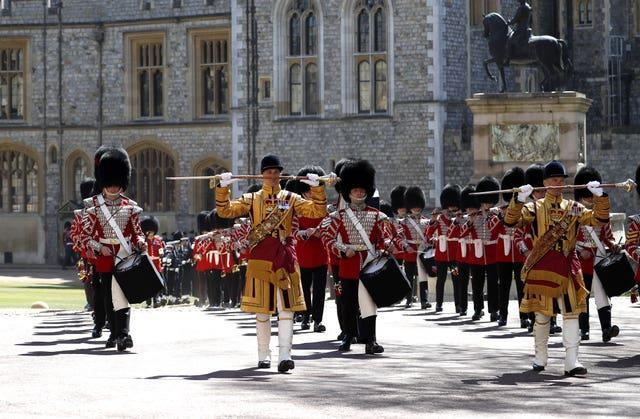 The Foot Guards Band march ahead of the funeral of the Duke of Edinburgh at Windsor Castle