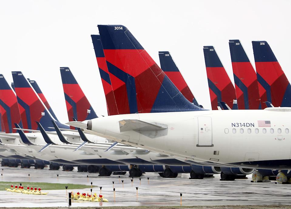 Planes belonging to Delta Air Lines sit idle at Kansas City International Airport on April 03, 2020 in Kansas City, Missouri. U.S. carriers reported an enormous drop in bookings amid the spread of the coronavirus and are waiting for a government bailout to fight the impact. Delta lost almost $2 billion in March and parked half of its fleet in order to save money. (Photo by Jamie Squire/Getty Images)