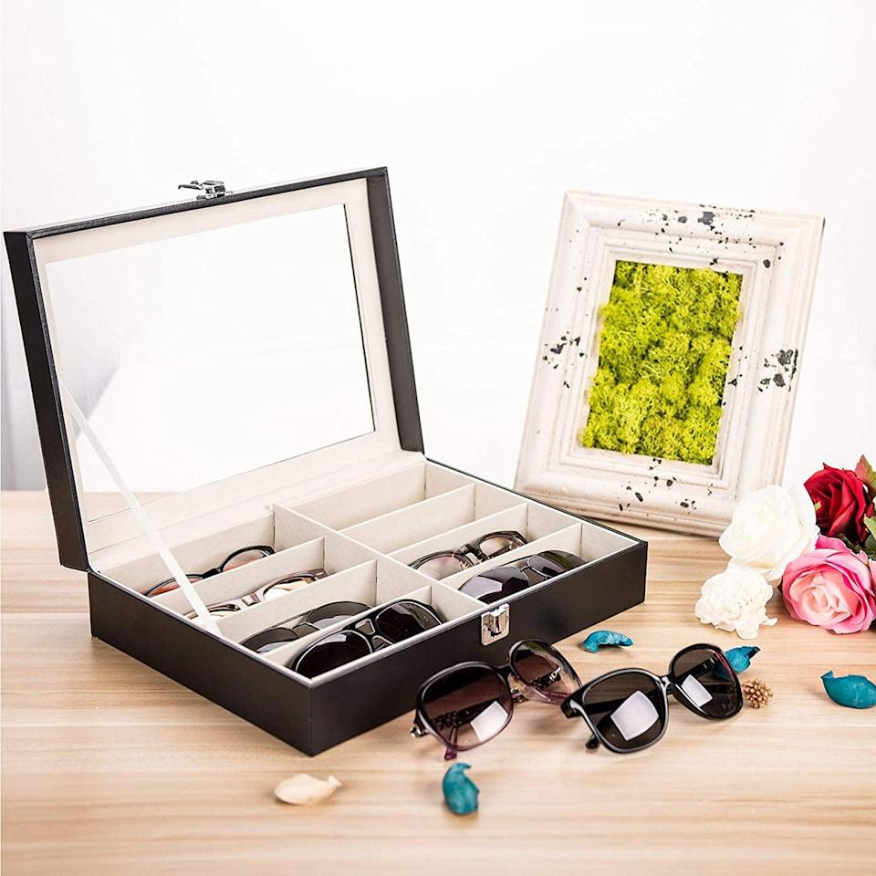 <p>The <span>Multi Sunglasses Organizer</span> ($20) is a great way for him to get organized. </p>