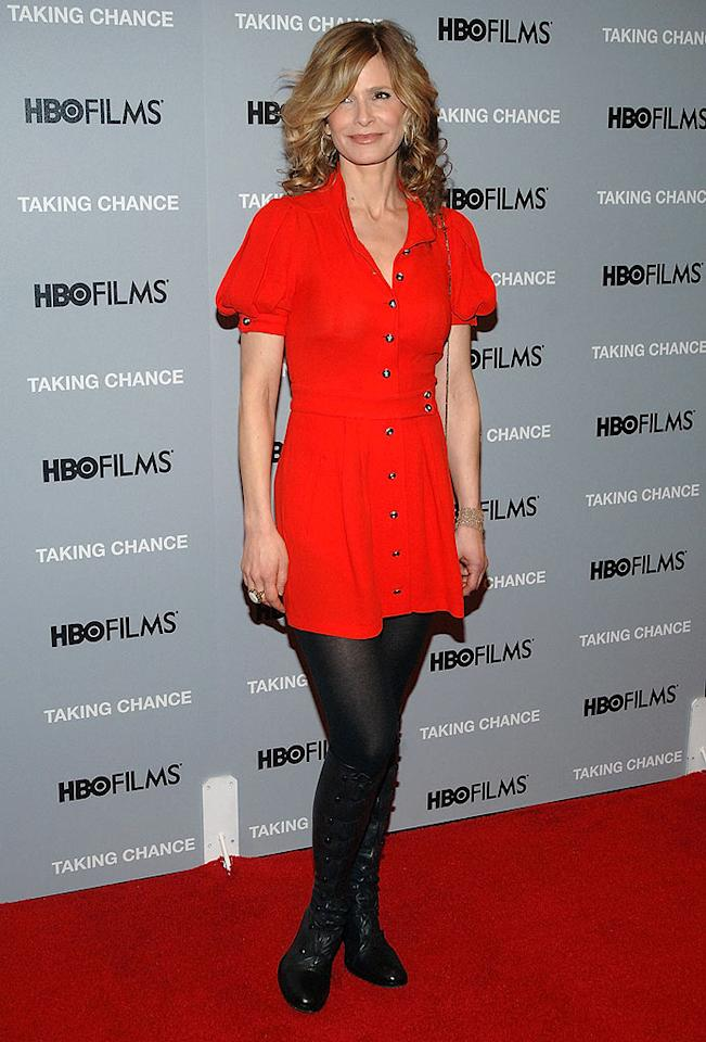 """Kyra Sedgwick kept it cute and casual in a red puff-sleeved Balenciaga button-down dress, tights, and knee-high boots at HBO's """"Taking Chance"""" opening. Duffy-Marie Arnoult/<a href=""""http://www.wireimage.com"""" target=""""new"""">WireImage.com</a> - February 11, 2009"""