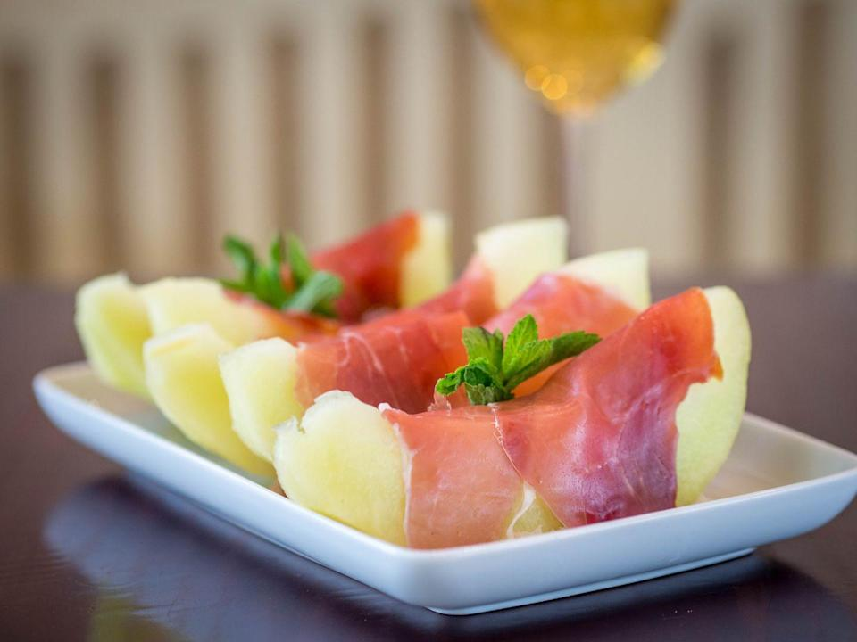 """<p>""""When I have guests over or want to be fancy, a plate of prosciutto with sliced melon is a beautiful and elegant option that's also Whole30 compliant,"""" says Rodgers. You'll get delicious protein and fat in the prosciutto, plus the <a href=""""https://www.womenshealthmag.com/food/a19981731/melon-nutrition/"""" rel=""""nofollow noopener"""" target=""""_blank"""" data-ylk=""""slk:cantaloupe"""" class=""""link rapid-noclick-resp"""">cantaloupe</a> is a good source of vitamins A and C. One-quarter of a melon and a few slices of prosciutto add up to the perfect-portioned snack to tide you over.</p>"""