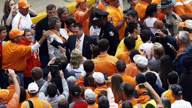 Tennessee head coach Butch Jones makes his way through fans during the Vol Walk before an NCAA college football game against South Carolina on Saturday, Oct. 19, 2013 in Knoxville, Tenn. (AP Photo/Wade Payne)