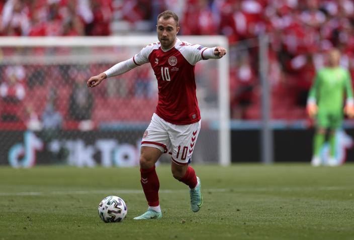 Denmark's Christian Eriksen controls the ball during the Euro 2020 soccer championship group B match between Denmark and Finland at Parken stadium in Copenhagen, Denmark, Saturday, June 12, 2021. Eriksen collapsed on the pitch and received medical assistance before being taken to hospital. (Wolfgang Rattay/Pool via AP)