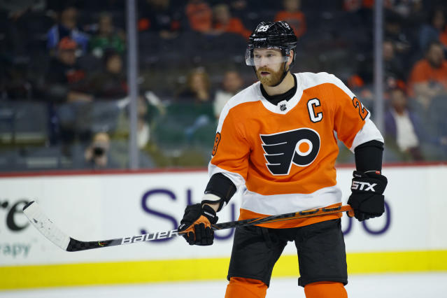 In this Sept. 19, 2019, photo, Philadelphia Flyers' Claude Giroux skates during a preseason NHL hockey game against the Boston Bruins in Philadelphia. Philadelphia plays a final preseason game in Switzerland, opens the season in the Czech Republic, plays one home game on Oct. 9 and then heads to Western Canada for three games in five days. (AP Photo/Matt Slocum)