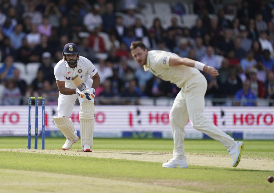 India's Rohit Sharma, left, plays a shot on a delivery by England's Ollie Robinson, right, during the first day of third test cricket match between England and India, at Headingley cricket ground in Leeds, England, Wednesday, Aug. 25, 2021. (AP Photo/Jon Super)