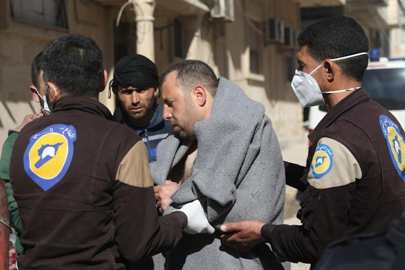Gas: A Syrian man is taken by civil defence workers to a small hospital in the town of Maaret al-Noman (Getty Images)