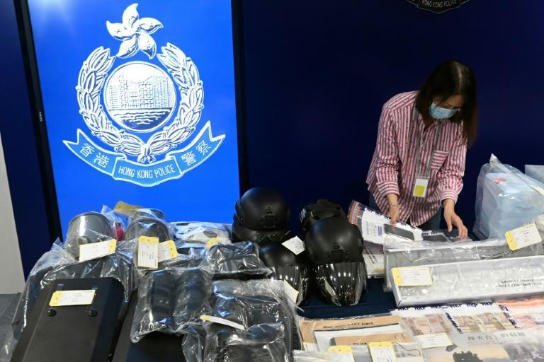 Hong kong police arrested nine people including six teenagers accused of plotting attacks on the city