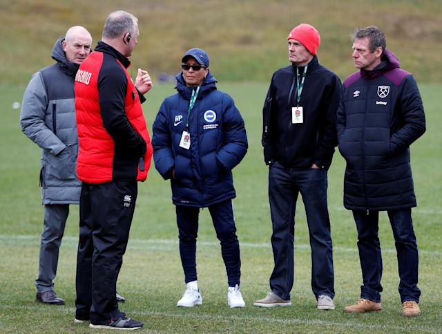 Rugby Union - England Training - Pennyhill Park, Bagshot, Britain - February 20, 2018 England team manager Richard Hill speaks to Mark Warburton, Brighton & Hove Albion's women's first-team manager Hope Powell and West Ham assistant manager Stuart Pearce during training Action Images via Reuters/Paul Childs