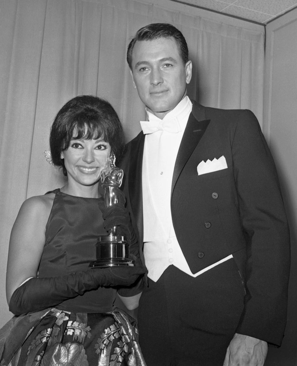 Rita Moreno poses with her Oscar and actor Rock Hudson after she was named best supporting actress of the year at the Academy Award Oscars at Santa Monica, Ca., on April 9, 1962. She won her award for best supporting actress for her part in the film West Side Story.