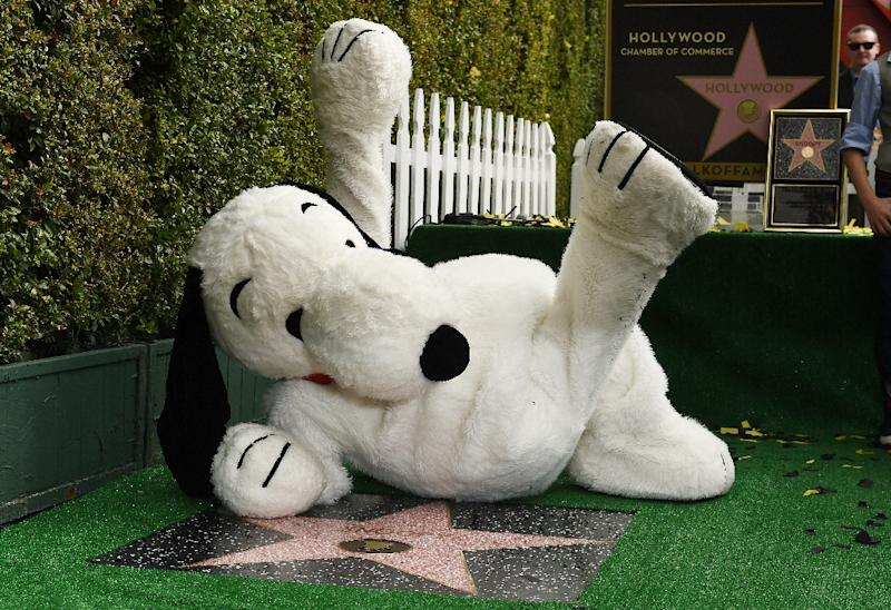 Snoopy poses on his star at the unveiling ceremony on the Hollywood Walk of Fame, on November 2, 2015