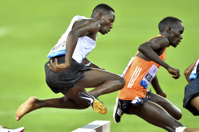 Kenya's Conseslus Kiprutu competes without a shoes on his way to win the men's 3000m steeplechase race during the Weltklasse IAAF Diamond League international athletics meeting in the Letzigrund stadium in Zurich, Switzerland, Thursday, August 30, 2018. (Walter Bieri/Keystone via AP)