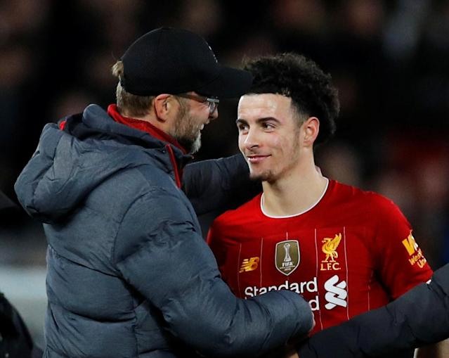 Liverpool's Curtis Jones (right) is congratulated by manager Jurgen Klopp after Jones' first senior goal beat Everton in Sunday's FA Cup third-round match at Anfield. (Reuters/Phil Noble)