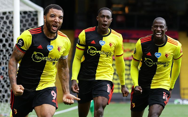 Watford's English striker Troy Deeney (L) celebrates after he scores takes a penalty and scores his team's second goal past Newcastle United's Slovakian goalkeeper Martin Dubravka - AFP