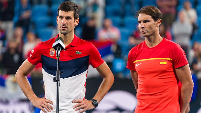 Novak Djokovic and Rafael Nadal, pictured here announcing the bushfire donation after the ATP Cup final.