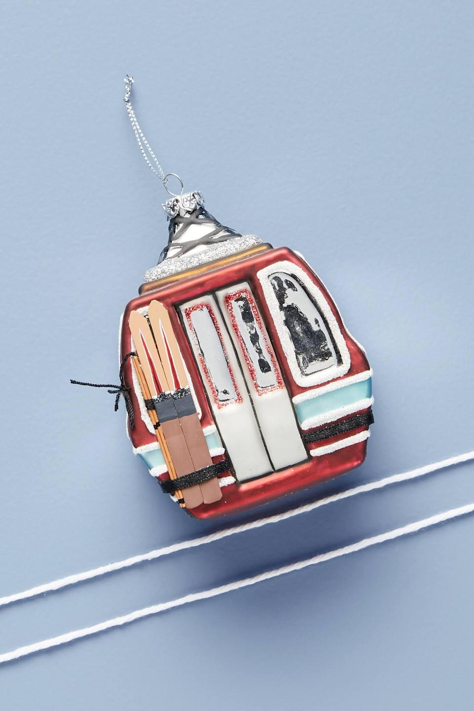 """<p>Skiers and snowboarders will love the details in this glass <a href=""""https://www.popsugar.com/buy/Ski-Gondola-Ornament-490513?p_name=Ski%20Gondola%20Ornament&retailer=anthropologie.com&pid=490513&price=18&evar1=casa%3Aus&evar9=46615300&evar98=https%3A%2F%2Fwww.popsugar.com%2Fhome%2Fphoto-gallery%2F46615300%2Fimage%2F46615383%2FSki-Gondola-Ornament&list1=shopping%2Canthropologie%2Choliday%2Cchristmas%2Cchristmas%20decorations%2Choliday%20decor%2Chome%20shopping&prop13=mobile&pdata=1"""" rel=""""nofollow noopener"""" class=""""link rapid-noclick-resp"""" target=""""_blank"""" data-ylk=""""slk:Ski Gondola Ornament"""">Ski Gondola Ornament</a> ($18).</p>"""
