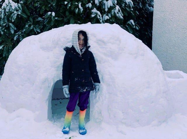 Sienna, five, who has built an igloo with her mother Nicola Black in their back garden in Aberdeen