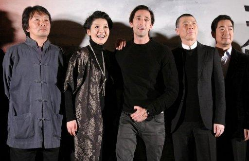 "Chinese screenwriter Liu Zhenyun, actress Xu Fan, American actor and film producer Adrien Brody, Chinese director Feng Xiaogang and actor Zhang Guoli (L-R) pose for the media during a press conference of Feng Xiaogang's epic ""Back to 1942"" movie premiere in Beijing on November 25, 2012. The film had a 210-million-yuan ($34 million) budget"