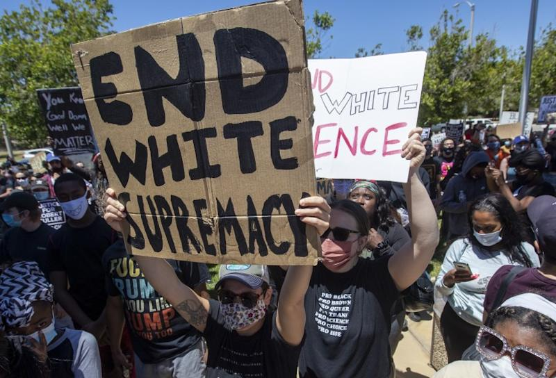 PALMDALE, CA - JUNE 13: Hundreds of demonstrators gathered at Los Angeles County Sheriff's Department's Palmdale Station on Saturday to demand justice the death of a young Black man, Robert Fuller, during a protest march on Saturday, June 13, 2020 in Palmdale, CA. (Brian van der Brug / Los Angeles Times)