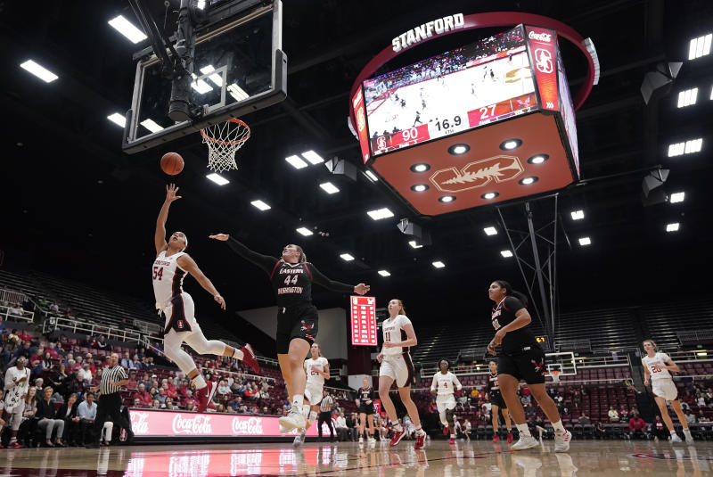 Stanford guard Jenna Brown (54) lays the ball up as Eastern Washington center Leya DePriest (44) defends during the second half of an NCAA college basketball game Tuesday, Nov. 5, 2019, in Stanford, Calif. Stanford won 92-27. (AP Photo/Tony Avelar)