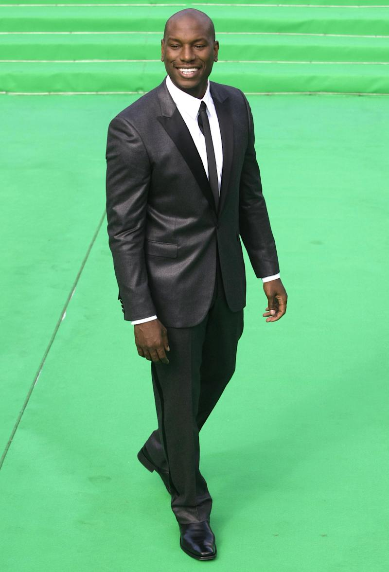 """FILE - In this Thurs., June 23, 2011 file photo, U.S. actor Tyrese Gibson arrives at the opening ceremony of the Moscow international film festival in Moscow. Gibson is a model-turned-singer-turned-actor, having released several R&B albums. After making his acting debut in John Singleton's """"Baby Boy,"""" he found himself with recurring roles in a couple of heavy-duty franchises: all three """"Transformers"""" films and a couple of the """"Fast and the Furious"""" movies. (AP Photo/Misha Japaridze, File)"""