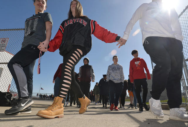 <p>Students, from left, Nariah Marzka, 14; Morgan Orelski, 15, and Travis Burge, 15, who joined about 500 students, leave leave Keck Field after taking part in a national school walkout event to protest gun violence and honor shooting victims at Fairview High School in Fairview Township, Erie County, Pa., Friday April 20, 2018. (Photo: Christopher Millette/Erie Times-News via AP) </p>