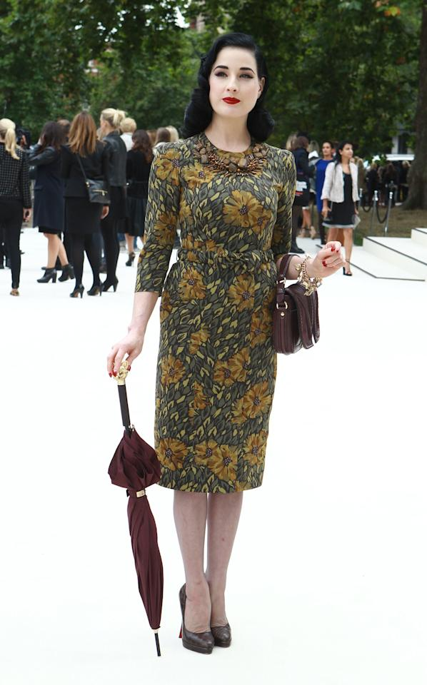 """<p class=""""MsoNormal""""><span>Burlesque star Dita Von Teese looked positively demure at the Burberry Prorsum show. <br></span></p><p class=""""MsoNormal""""><span>(Photo by Fred Duval/Getty Images)</span></p>"""
