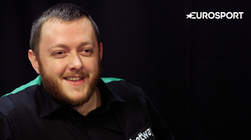 Last year's beaten finalist Mark Allen hard to fend off a strong challenge from Jak Jones to seal a place in the third round.