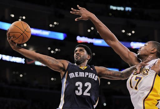 Memphis Grizzlies guard O.J. Mayo (32) goes up for a shot as Los Angeles Lakers center Andrew Bynum (17) defends during the first half of their NBA basketball game, Sunday, Jan. 8, 2012, in Los Angeles. (AP Photo/Mark J. Terrill)