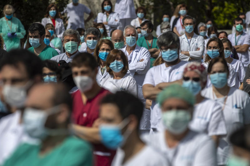 Health workers hold a minute of silence in Madrid, Spain, Monday, April 20, 2020. (AP Photo/Manu Fernandez)
