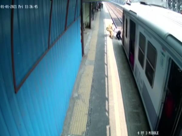 Mumbai police saves man from getting crushed by train (CCTV Footage).