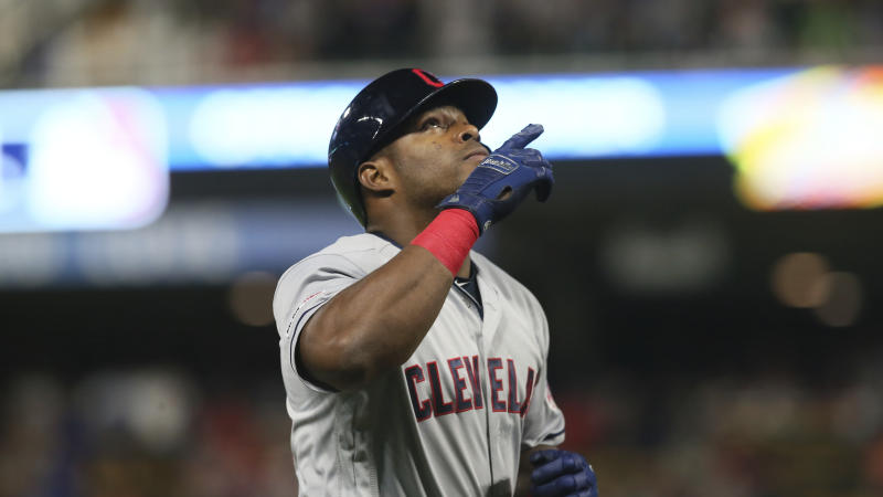 Cleveland Indians' Yasiel Puig celebrates his home run against the Minnesota Twins in a baseball game Saturday, Aug. 10, 2019, in Minneapolis. (AP Photo/Jim Mone)