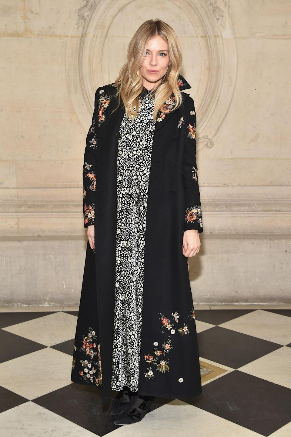 <p>Sienna Miller was a true bohemian in a printed maxi dress and coat. <i>[Photo: Getty]</i> </p>