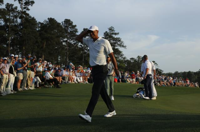 Tiger Woods of the U.S. walks off the 18th green after finishing second round play of the 2018 Masters golf tournament at the Augusta National Golf Club in Augusta, Georgia, U.S., April 6, 2018. REUTERS/Brian Snyder