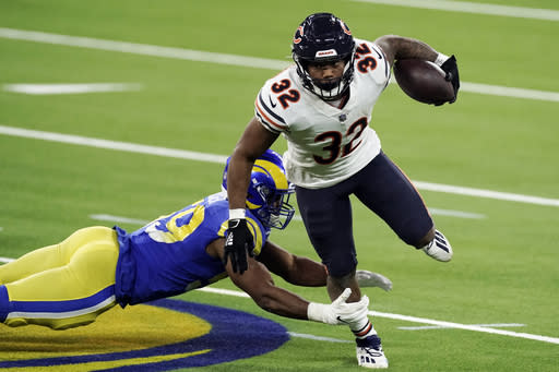 Chicago Bears running back David Montgomery (32) runs around Los Angeles Rams middle linebacker Micah Kiser during the second half of an NFL football game Monday, Oct. 26, 2020, in Inglewood, Calif. (AP Photo/Ashley Landis )
