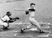 FILE - In this April 18, 1960, file photo, Ted Williams of the Boston Red Sox knocks the ball out of the park for a home run in the second inning against the Washington Senators in Washington. Growing up in the Washington suburbs during the 1960s, the local baseball team was a lost cause. So we found other things to root for under the wavy roof at D.C. Stadium and RFK. Like the time Ted Williams came to town. (AP Photo, File)