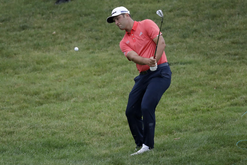FILE - Jon Rahm, of Spain, chips for birdie on the 16th hole during the final round of the Memorial golf tournament in Dublin, Ohio, in this Sunday, July 19, 2020, file photo. Rahm hit the most memorable shot all year with a lob wedge. (AP Photo/Darron Cummings, File)