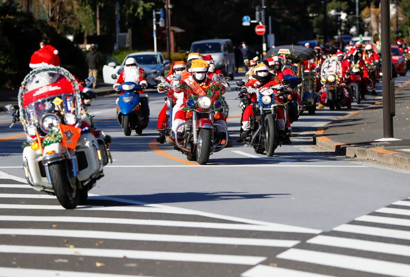 People dressed in Santa Claus costumes ride their motorbikes during Xmas Toy Run parade amid the coronavirus disease (COVID-19) outbreak, in Tokyo