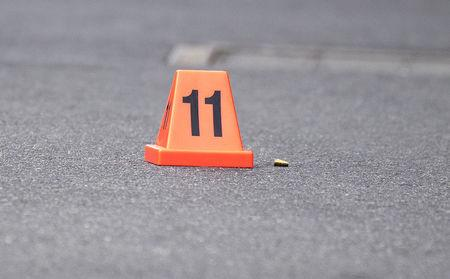 A bullet casing is seen at the scene of a multiple shooting outside Love Machine nightclub in Prahran, Melbourne, Australia April 14, 2019. AAP Image/Ellen Smith/via REUTERS