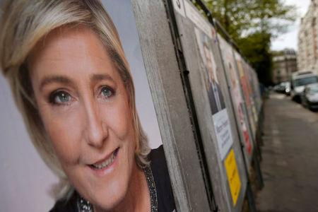 A campaign poster of Marine Le Pen, French National Front (FN) political party leader and one of the eleven candidates who runs in the 2017 French presidential election, is seen in Paris, France, April 10, 2017. REUTERS/Gonzalo Fuentes