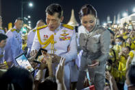 King Maha Vajiralongkorn and Queen Suthida greet supporters in Bangkok, Thailand, Sunday, Nov. 1, 2020. Under increasing pressure from protesters demanding reforms to the monarchy, Thailand's king and queen met Sunday with thousands of adoring supporters in Bangkok, mixing with citizens in the street after attending a religious ceremony inside the Grand Palace. (AP Photo/Wason Wanichakorn)