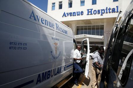 Paramedic exits an ambulance at the Avenue hospital in Nairobi