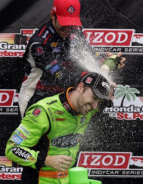 Winner James Hinchcliffe, bottom, of Canada, is doused by third-place finisher Marco Andretti after the IndyCar Series Honda Grand Prix of St. Petersburg auto race, Sunday, March 24, 2013, in St. Petersburg, Fla. (AP Photo/Chris O'Meara)